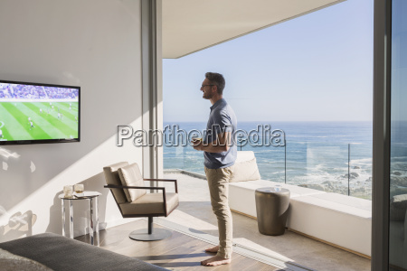 man watching soccer on tv at