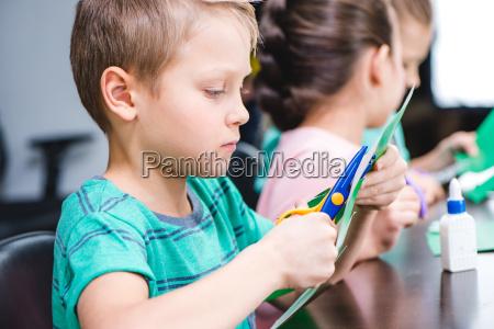 schoolchildren making applique