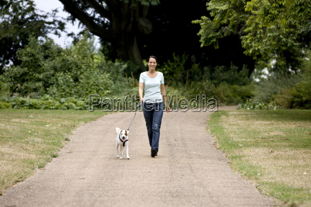 a young woman walking her dog