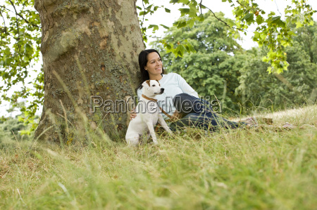 a young woman sitting on the