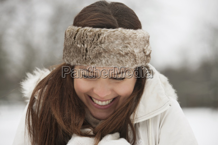 a young woman wearing a fur