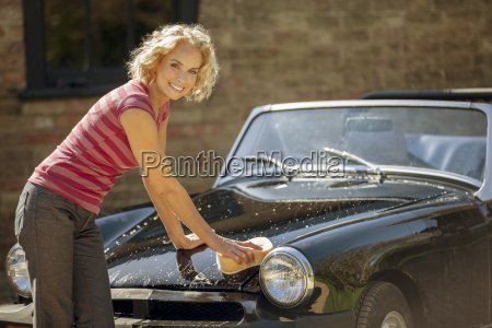 a mature woman washing a classic