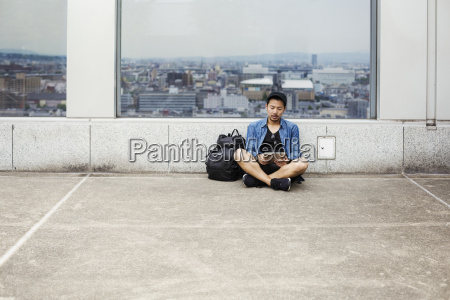a man sitting on the floor