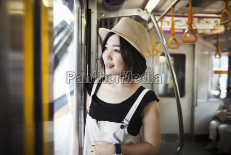 young woman wearing a hat traveling