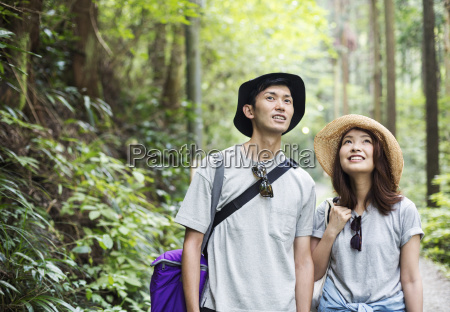 smiling young woman and man standing