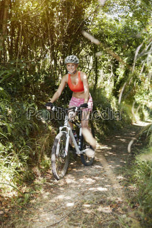 young woman riding mountainbike on a
