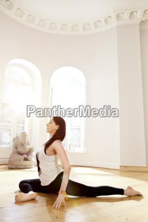 woman in sunny yoga studio getting