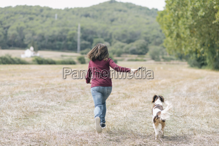 back view of woman running with