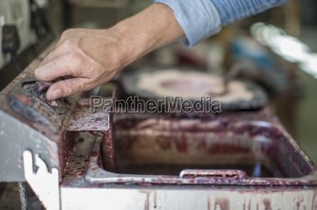 artist mixing sculpting mould wax