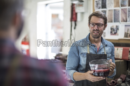 artist holding mould wax in a