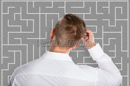 young businessman looking at labyrinth