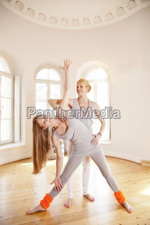 woman in sunny yoga studio holding