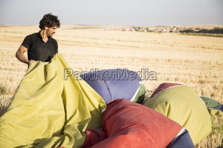 man packing up a hot air