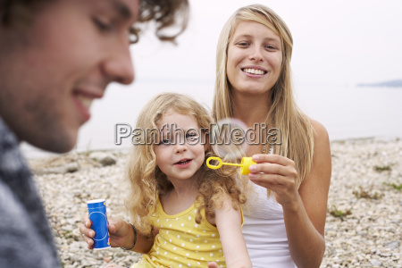 parents with daughter at a lake