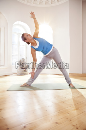 woman in extended triangle pose in