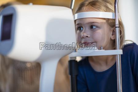 girl doing eye test at the
