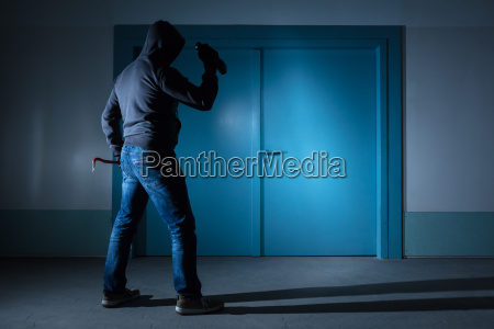 thief standing outside the door