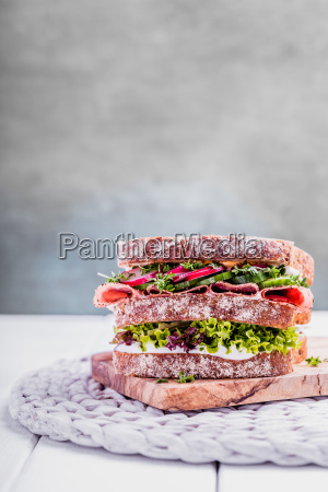 sandwich with salami cress cucumber and
