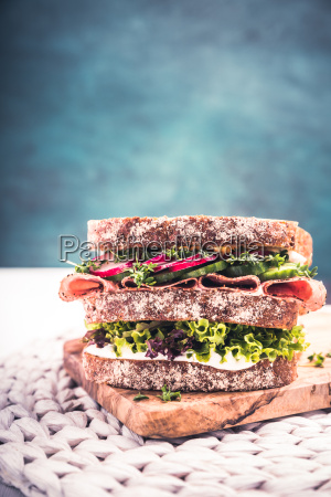 sandwich with salami cress pickles and