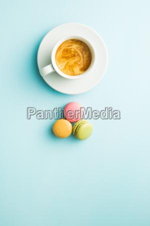 tasty sweet macarons and coffee cup