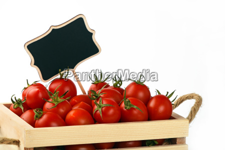 red tomatoes in box with price