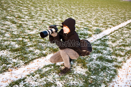 young boy takes pictures of acres