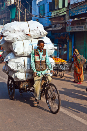 cycle rickshaw driver with passenger in