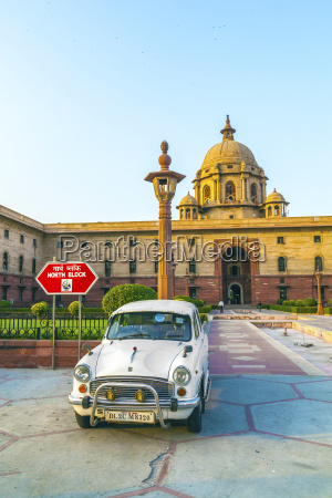 official hindustan ambassador cars parked outside