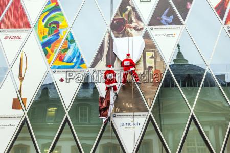 two climber dresses as santa claus