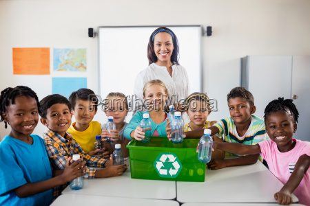portrait of pupils and teacher recycling
