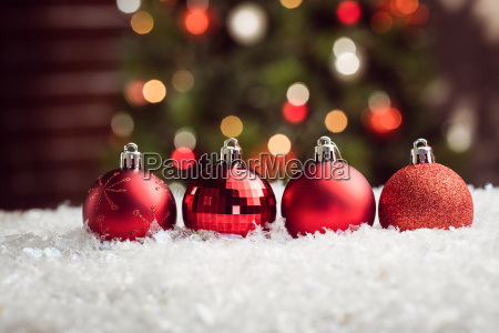 composite image of christmas baubles lined