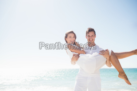 handsome man holding his girlfriend