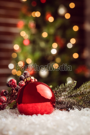 composite image of christmas bauble and