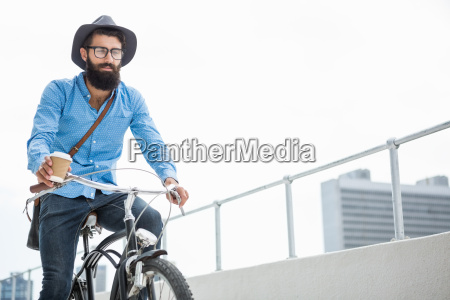 hipster doing bicycle