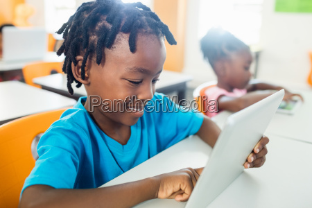 side view of pupil using tablet