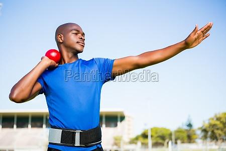 male athlete preparing to throw shot