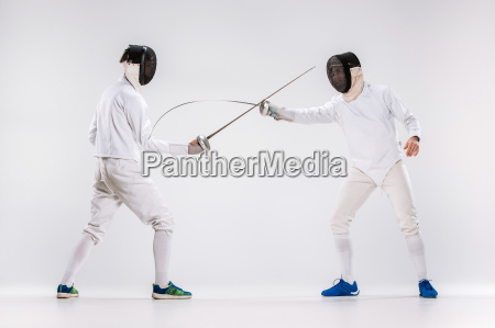 the two men wearing fencing suit