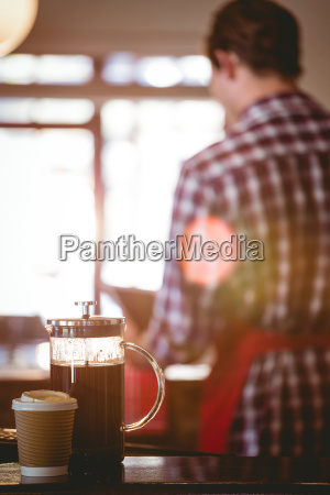 french press and cup of coffee