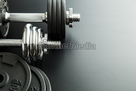 the metal dumbbell and weights