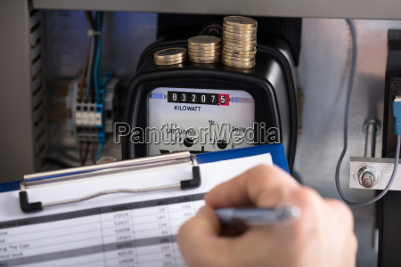 technician hand writing reading of meter