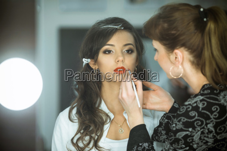 professional expert makeup artist prepares very