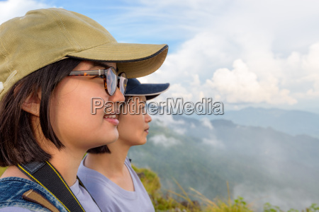 face two young women watching nature