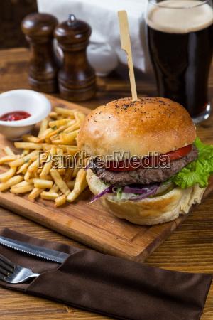 hot burger serving on wooden board