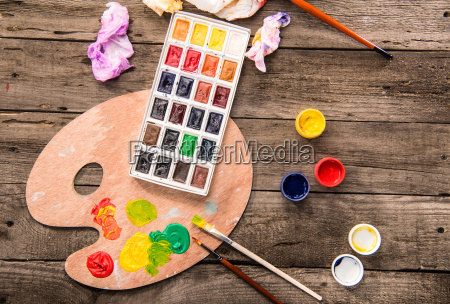 paints and palette on table