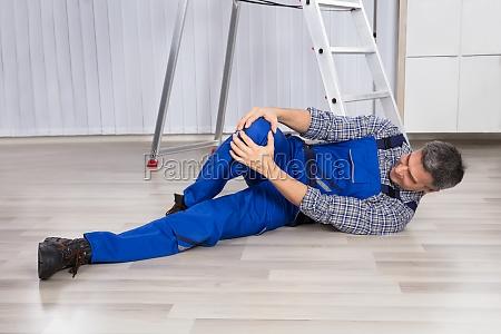 an injured man holding his leg