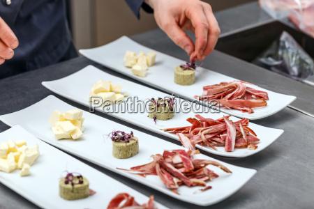 male chef garnishing his dish