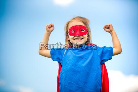 funny little girl plaing power super
