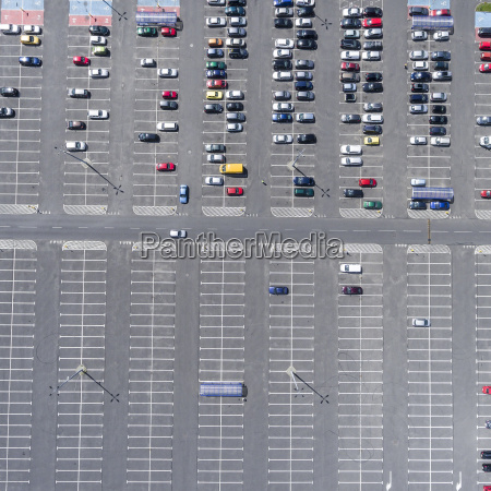 supermarket roof and many cars in