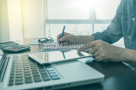 working process man writing on note