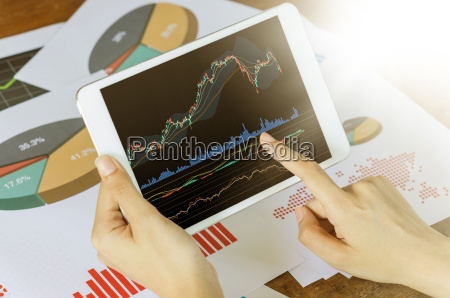 business concept womans hands using tablet